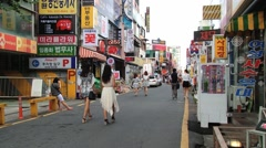 People walk by the street of the city in Daejeon, Korea. Stock Footage