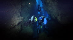 Chaotic hoard of scuba divers swimming in cavern in Solomon Islands, HD, UP26962 Stock Footage