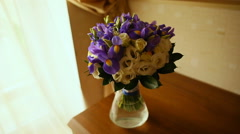 Wedding bouquet in a vase on the table Stock Footage