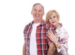 Retired couple wearing summer outfits on white isolated background Stock Photos