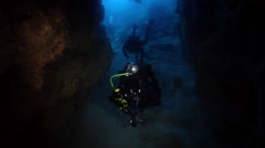 Group of scuba divers swimming in cavern in Galapagos Islands (Ecuador), HD, - stock footage