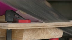 Sawing of wooden plank using hacksaw Stock Footage