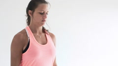 Fit young woman doing bicep curl exercises with dumb bells Stock Footage