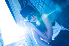 Rapper girl with headphones in a european city Stock Photos