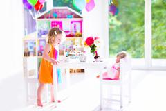 Little girl at doll tea party Stock Photos