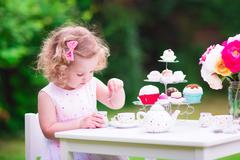 Little girl at tea party - stock photo