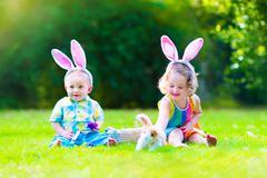Children at Easter egg hunt Stock Photos