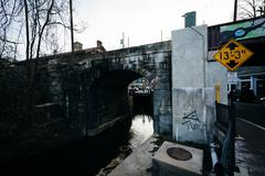 Old railroad bridge and creek in downtown Ellicott City, Maryland. Stock Photos