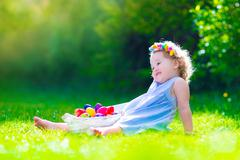 Little girl on Easter egg hunt - stock photo