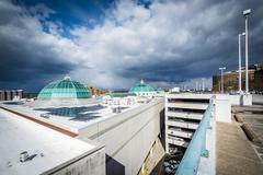Storm clouds over a parking garage in Towson, Maryland. Stock Photos