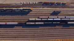 Looking down on busy railroad rail yard, many trains, tracks Stock Footage