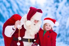 Kids and Santa with Christmas presents - stock photo