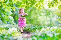 Little girl at Easter egg hunt Stock Photos