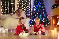 Family with kids celebrating Christmas at home - stock photo