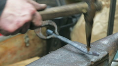 Making decorative element in the smithy on the anvil Stock Footage