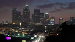 4K time lapse of the Los Angeles city skyline from a high angle view at dusk - stock footage