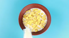 Milk poured onto cereal Stock Footage