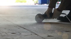 Industrial workers working with Electric grinding cutting concrete. Stock Footage
