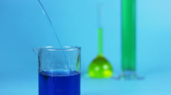 Test Tube , chemical experience, blue background Stock Footage