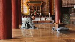 Monk prays in the Buddhist temple in Haeinsa monastery, Haeinsa, Korea. Stock Footage