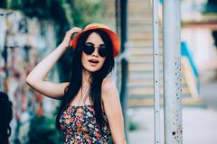 beautiful girl poses for camera in the city - stock photo