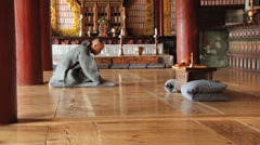 Monk prays in the Buddhist temple in Haeinsa monastery, Haeinsa, Korea. Stock Footage