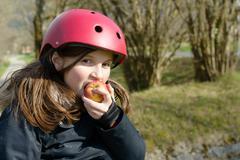 preteen in roller skate, eat an apple - stock photo
