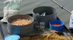 Fishing food and worms in the boxes, close up, by Pakito. Stock Footage