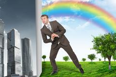 Businessman changing city on nature landscape - stock photo
