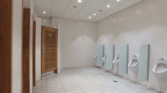 Urinals and toilet cubicles Stock Footage