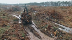 Aerial view of heavy machine moves over Deforestation Stock Footage