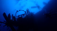 Ocean scenery vertical wreck, shooting straight up with divers and boats on the Stock Footage