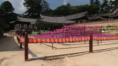 Pilgrims walk by the yard in Haeinsa temple in Haeinsa, Korea. Stock Footage