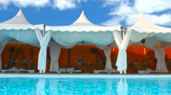 Luxury lounge bed in a nice pool area - Time lapse( Clouds) Stock Footage