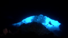 Distant scuba diver swimming in cavern in Solomon Islands, HD, UP27724 Stock Footage