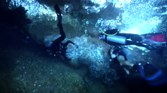 Group of scuba divers swimming in cavern in Solomon Islands, HD, UP27490 Stock Footage