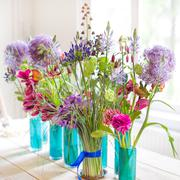 Beautiful spring flowers on wooden table Stock Photos