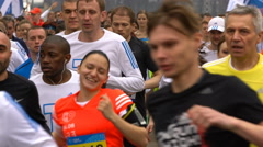 A lot of runners run the annual public marathon in Moscow. Slow motion. Stock Footage