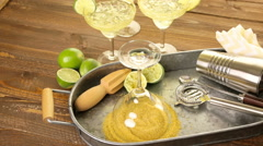 Classic lime margaritas on the rocks. Stock Footage
