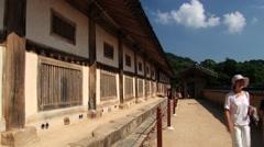 People walk in Haeinsa temple in Haeinsa, Korea. Stock Footage