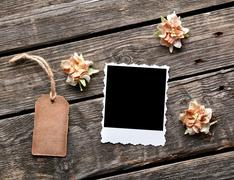 Instant photo frame and gift tag with flowers - stock photo