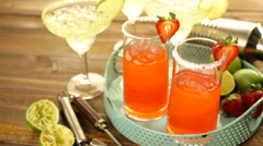 Classic lime and strawberry margaritas on the rocks. Stock Footage