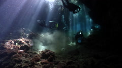 Group of scuba divers swimming in cavern in Solomon Islands, HD, UP26811 Stock Footage