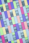 Modern exterior facade of a colorful office building. - stock photo