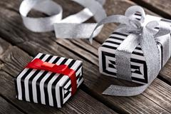 Gift boxes with curved silver ribbon - stock photo