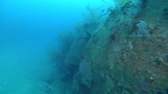 Ocean scenery World War II, WW2 Japanese freighter, mangled hull shows where - stock footage
