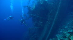 Group of scuba divers swimming on wreckage in Solomon Islands, HD, UP26982 Stock Footage