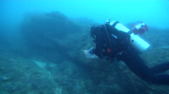 Scientific diver on rocky reef in Australia, HD, UP26506 Stock Footage