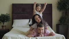 Happy Family Lying on Bed at Home Stock Footage