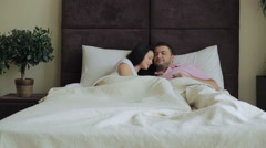 Happy Family Lying on Bed at Home - stock footage